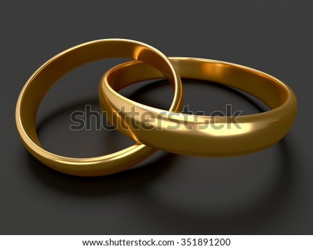 Heart with two connected gold wedding rings on black