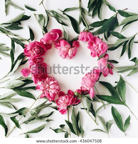 heart wreath frame with peonies flat lay top view