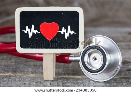 Heartbeat and stethoscope. Medecine concept. Blackboard with Heartbeat and stethoscope - stock photo