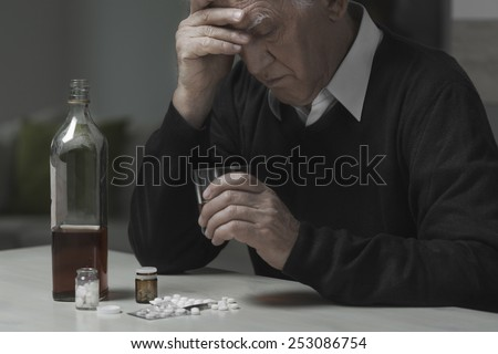 Heartbroken widower use drugs and alcohol to kill sadness - stock photo