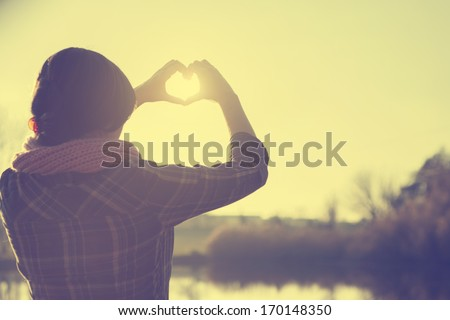 Hearth symbol in sunset - stock photo