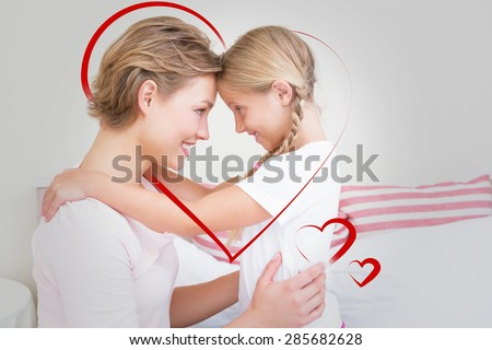 Hearts against mother and daughter smiling at each other