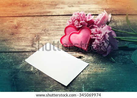 hearts and a bouquet of  peonies on wooden board, Valentines Day background