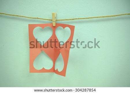 Hearts and clothe pins , vignetting and vintage tone , space for text copy