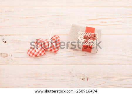 Hearts and gift on wooden background. Valentines day. Beautiful.