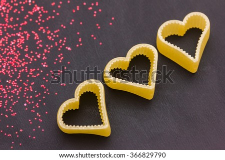 Hearts and glitters on a blackboard - stock photo