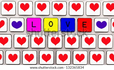 Hearts and love letters on the white keyboard - stock photo