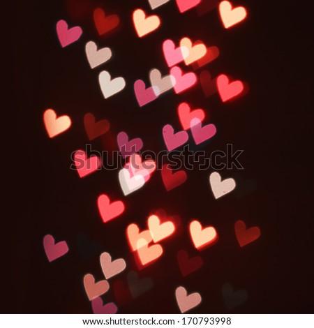 Hearts Bokeh in dark. Valentines Day Card - stock photo
