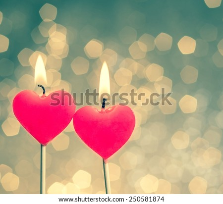 hearts candles on vintage bokeh as background vintage style, valentine day and love concept - stock photo