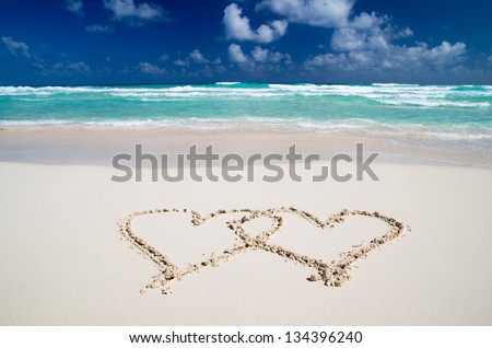hearts drawn in the sand - stock photo