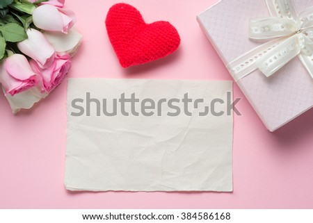 Hearts, flower, gift box and greeting card on pink wooden background. Valentines day or Woman day concept. Top view. Copy Space - stock photo