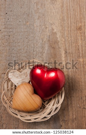 Hearts in a basket on a wooden table