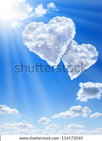 Hearts in clouds against a blue clean sky - stock photo