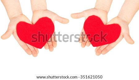 Hearts in the children hands. Love and help concept. Isolated on white background - stock photo