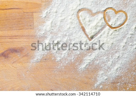 hearts of flour on a wooden table - stock photo