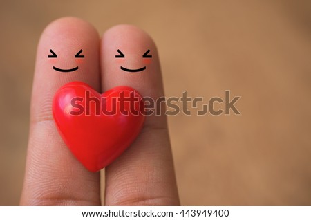 Hearts on finger with blurred wood background, heart background, heart valentines. - stock photo