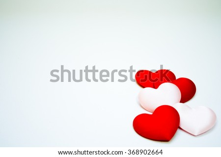 Hearts on grey background. - stock photo