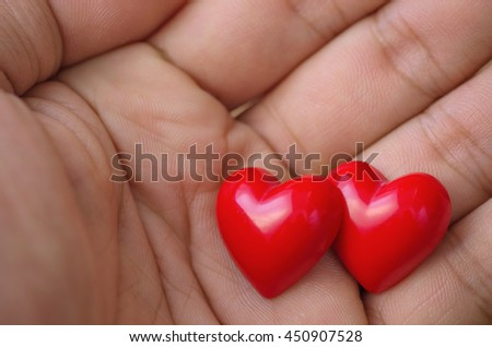 Hearts on hand, heart background, heart valentines. - stock photo