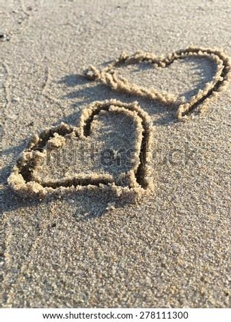 hearts on sand - stock photo