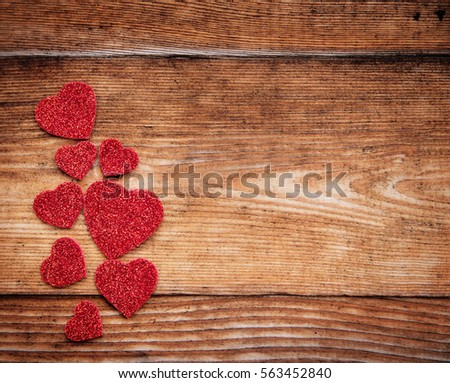 Hearts on wooden background. Valentine day