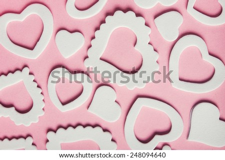 Hearts white shape on ping background