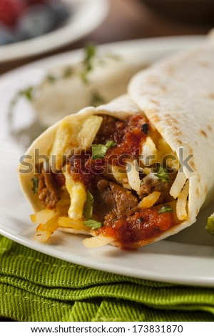 Hearty Chorizo Breakfast Burrito with Eggs, Cheese, and Hashbrowns - stock photo