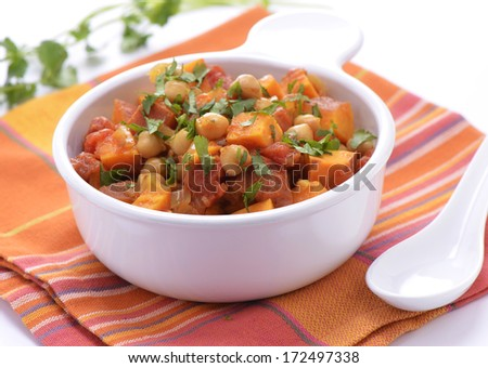 Hearty healthy chickpea and sweet potato curry in white bowl, horizontal format - stock photo
