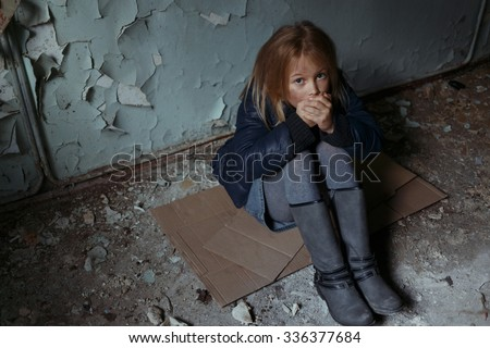 Heat me. Depressed miserable girl sitting on the floor and feeling cold while feeling sad - stock photo
