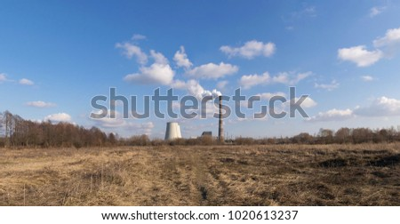 Heat power plant rising on the horizon on a sunny day pano image