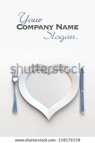 Heat shaped dish with knife and fork with lots of copy space - stock photo