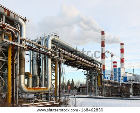 Heat station and line pipe winter view - stock photo