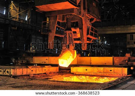 heated steel pigs the crane from takes out furnaces