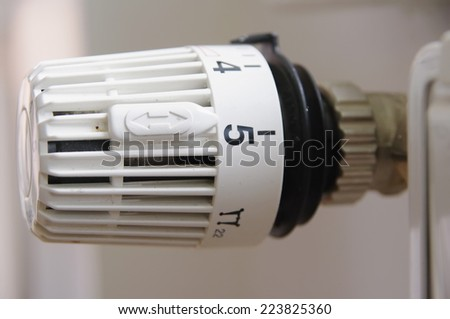 Heater thermostat. Close-up. Isolated on white background. - stock photo