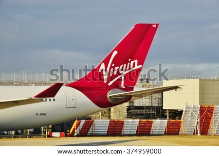 HEATHROW, ENGLAND -3 FEBRUARY 2016- An Airbus A330 from the British airline Virgin Atlantic (VS) at the London Heathrow International Airport (LHR). - stock photo
