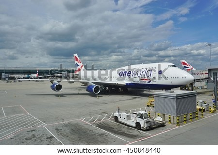 HEATHROW, ENGLAND -10 JUNE 2016- A Boeing 747 400 from British Airways (BA) with a One World livery at London Heathrow Airport (LHR). - stock photo