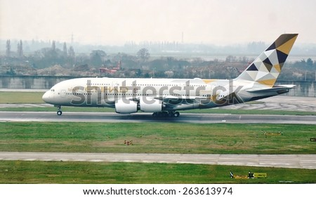 HEATHROW, ENGLAND -16 MARCH 2015- Editorial: London Heathrow International Airport (LHR) is one of the main airports in the world for the double-decker Airbus A380 super jumbo jets. - stock photo
