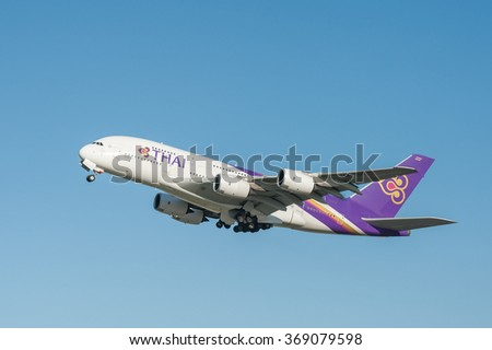 HEATHROW, LONDON, UK - JANUARY 28: A five hundred seat Thai Airways Airbus A380 departing from a crystal clear Heathrow Airport, London, UK on January 28, 2016 - stock photo