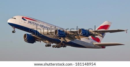 HEATHROW, LONDON, UK - MARCH 9: British Airways A380 (G-XLEA) taking off on March 9, 2014 at London Heathrow Airport, London, UK. - stock photo