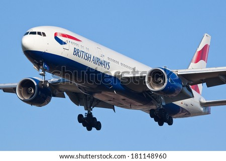 HEATHROW, LONDON, UK - MARCH 9: British Airways Boeing 777 (G-YMMN)approaching to land on March 9, 2014 at London Heathrow Airport, London, UK. - stock photo