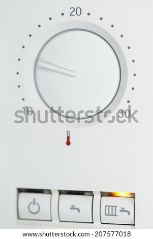 heating controller detail shot on with temperature scale - stock photo
