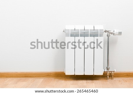 heating radiator at home - stock photo