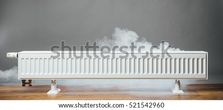 heating radiator at home with warm steam
