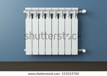 Heating radiator in a room with laminated wooden floor - stock photo