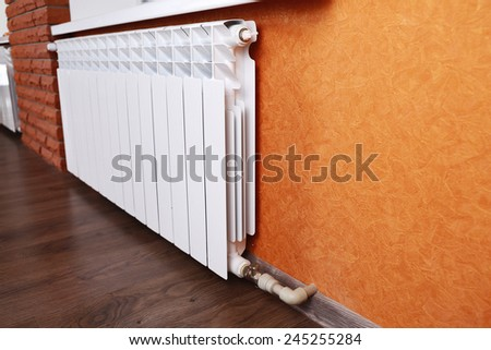 Heating radiator in room - stock photo