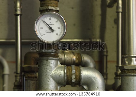 Heating system pressure gauge in a eco-house - stock photo