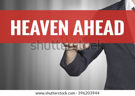 Heaven Ahead word on virtual screen touch by business man at red tab - stock photo