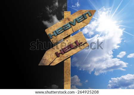 Heaven and Hell - Sign on Blue Sky. Wooden directional sign with two arrows in opposite direction with text heaven and hell on blue and black sky with clouds and sun rays - stock photo