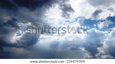 Heaven / mystical background - sunlight passes through the storm clouds and cumulus clouds - stock photo