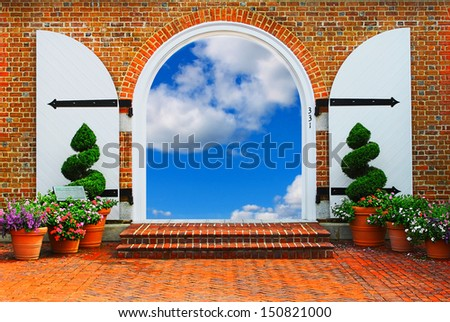 Heavens doorway. Doorway through an arch opening to a beautiful cloud filled sky leading to the heavens. - stock photo