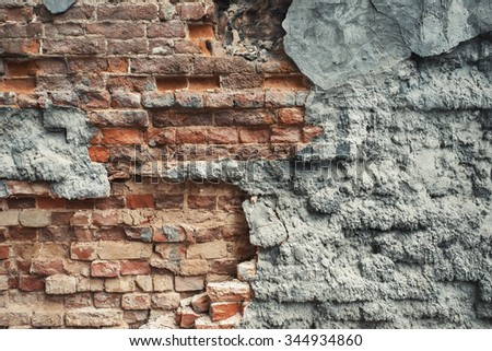 Heavily damaged brick wall texture background. Vintage effect.  - stock photo
